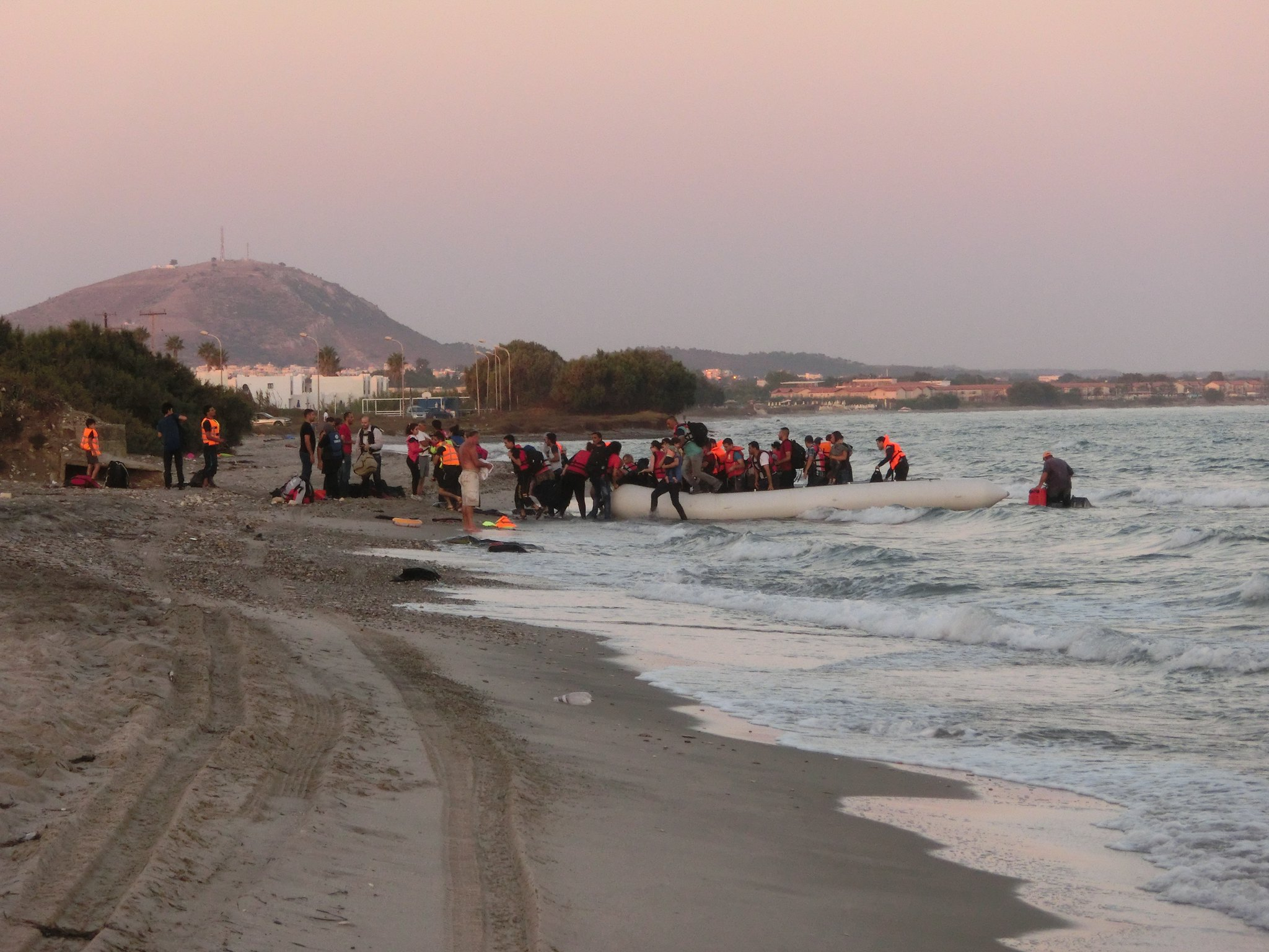A rubber boat carrying around 50 migrants and refugees arrives on the Greek island of Kos