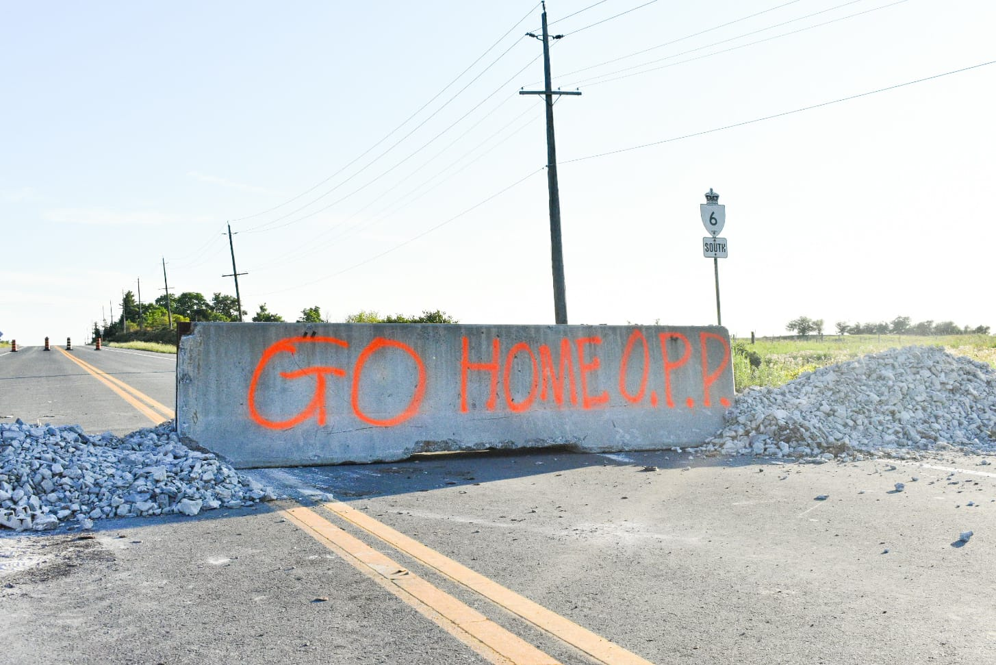 Barrier on road with grafitti